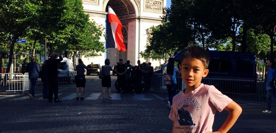 Boy In Front of Arc de Triomphe on Bastille Day